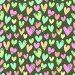 Seamless pattern with a lot of hearts on a green background — Stock Vector