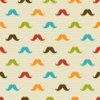 Seamless pattern of colored mustache on striped background — Stock Vector