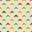 Stock Vector: Seamless pattern of colored mustache on striped background