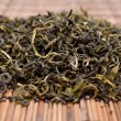 Dried green tea on the background — Stock Photo