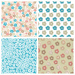 Set of seamless flower patterns — Stock Vector