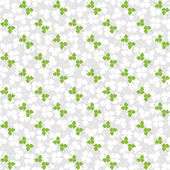 Seamless decorative floral pattern with clover, shamrocks — Stock Vector