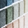 Carpet samples in many shades and colors — Stock Photo
