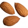 Three almonds isolated on white background — Stock Photo