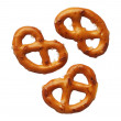 Three pretzels isolated on white background, close-up — Stock Photo