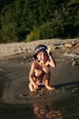 Boy playing at beach — Stock Photo