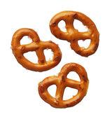 Three pretzels isolated on white background, close-up — Stock Photo