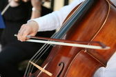 Playing cello, hand close up — Stock Photo