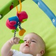 Baby looking up at a mobile toy — Stock Photo #21980215