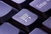Shopping cart icon on a computer keyboard key — Stock Photo