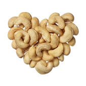 Cashew nuts heart isolated on white background — Stock Photo