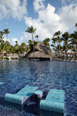 Tropical resort swimming pool in Punta Cana, Dominican Republic — Stock Photo