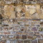 Primitive ancient masonry wall — Stock Photo