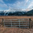 Fence Gate with Snowy Mountains — Stock Photo