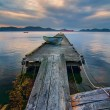 Rickety Island Dock with Mountains and Tankers in Distance — Stock Photo