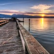 Постер, плакат: Pier With Sunrise Sunstar