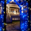 Stock Photo: Blue Christmas Light Archway With Snowman