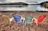 Four Patio Chairs Looking Over Lake — Stock Photo