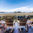 Four Chairs on Deck Overlooking Beach — Stock Photo #30950159