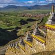 Wall with Stupas and Distant town — Stock Photo