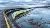 Pier With Native Mural on Side — Stock Photo