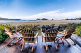 Four Chairs on Deck Overlooking Beach — Stock Photo