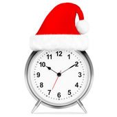 Alarm clock with christmas santa hat isolated — Stock Photo