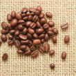 Coffee beans on sacking — Stock Photo