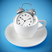 Alarm clock in the white cup on blue background — Stockfoto