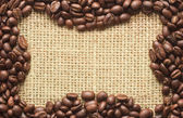 Coffee beans frame on sacking — Stock Photo