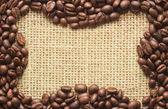 Coffee beans frame on sacking — Stockfoto