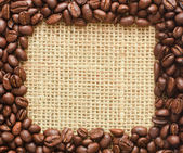 Coffee beans square frame on sacking — Stock Photo