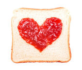 Slice of bread with fruit jam heart shape — Stock Photo