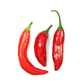 Three red hot chili peppers on white — Stock Photo
