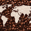 Stock Photo: World map with coffee beans background