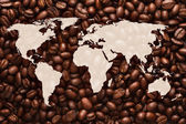 World map with coffee beans background — Stock Photo