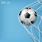 Soccer ball in the goal net on the blue background — Stock Photo