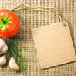 Tomato and garlic vegetables and price tag on sacking background — Stock Photo
