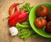 Healthy fresh vegetables ingredients for cooking in rustic setti — Stock Photo