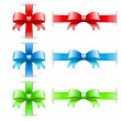 Bows with ribbons on white in red green and blue colors — Stock Vector