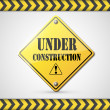 Under construction sign on white — Stock Vector