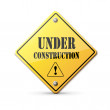 Under construction sign on white - Stock Vector
