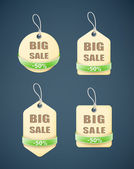 Set of big sale paper labels with green ribbon — Stock Vector
