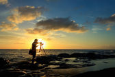 Silhouette shot of a photographer at sunset. Taken at the Tip of Borneo, Borneo, Sabah, Malaysia. — Stock Photo