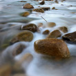 Stock Photo: Long exposure shot of river and rocks