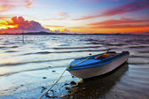 A boat with beautiful sunset at the background — Stock Photo