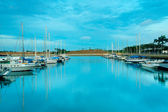 Reflection of boats and the sky at the harbour — Stock Photo