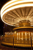 A long exposure shot of a merry go round in motion — Stock Photo