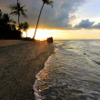 Sunset at a beach in Borneo, Sabah, Malaysia - Stock Photo