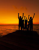 Silhouette of children at sunset — Stock Photo